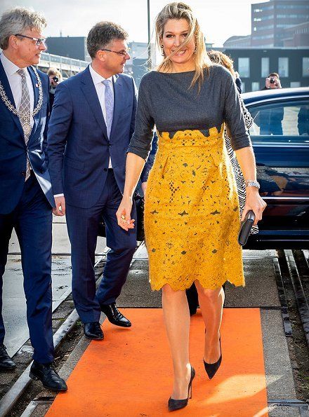 Queen Maxima's outfit is from the fashion house Natan. yellow lace skirt by Natan and grey top