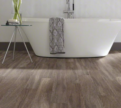 New flooring choices make the look of wood practical even in a bathroom