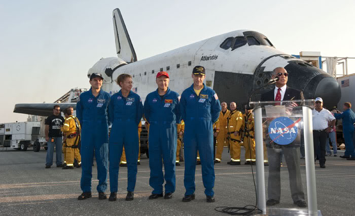 With the STS-135 crew at his side, NASA Administrator Charlie Bolden addresses the media about the now-concluded Space Shuttle Program, on July 21, 2011.
