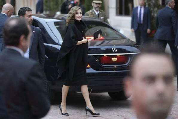 Queen Letizia wore Hugo Boss Capina wool cape, Prada Toe Pump, Felpe Varela drees and Clutch bag