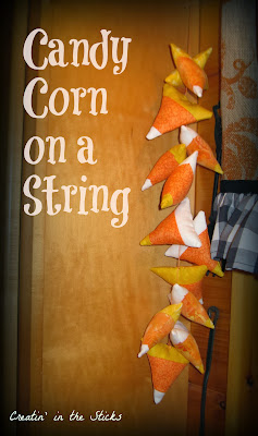 http://createinthesticks.blogspot.com/2013/10/halloween-window-scape-candy-corn-on.html
