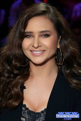 Nelly Karim, an Egyptian actress, was born on December 18, 1974 in Alexandria, Egypt.