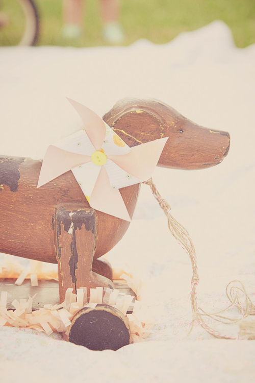 Summer Pastel Party Inspiration from Sweet Lulu - how sweet is this pretty paper pinwheel on that old wooden dog?