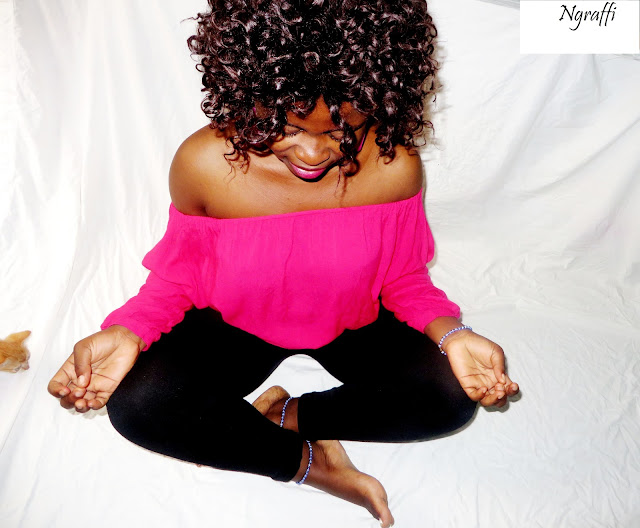 african blogger doing yoga in cameroon