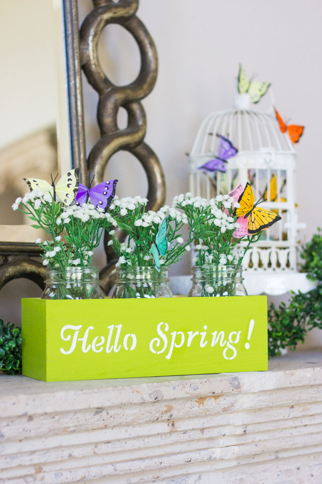 Make this spring flower box centerpiece with mason jars, butterflies, and faux baby's breath!