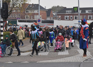 Partiers in wheelchairs being led front and center for the arrival of Sinterklaas, Zaandam, The Netherlands