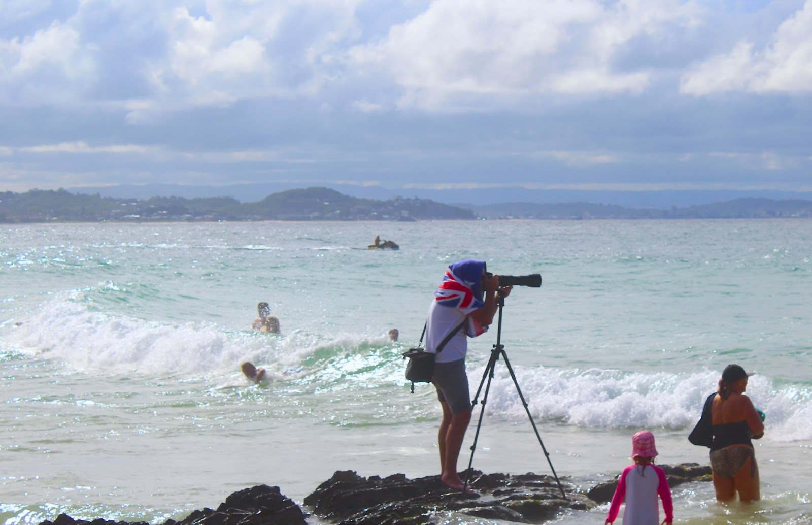 A camera operator at Surf Event