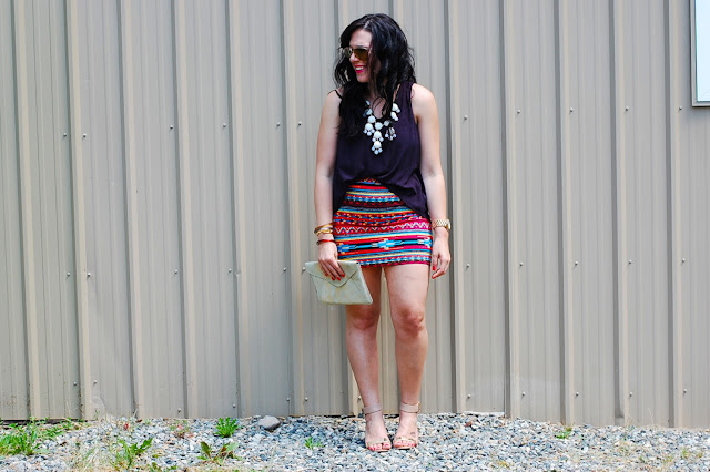 Southwestern bodycon mini skirt, hi-low tank and an Ily Couture statment necklace.