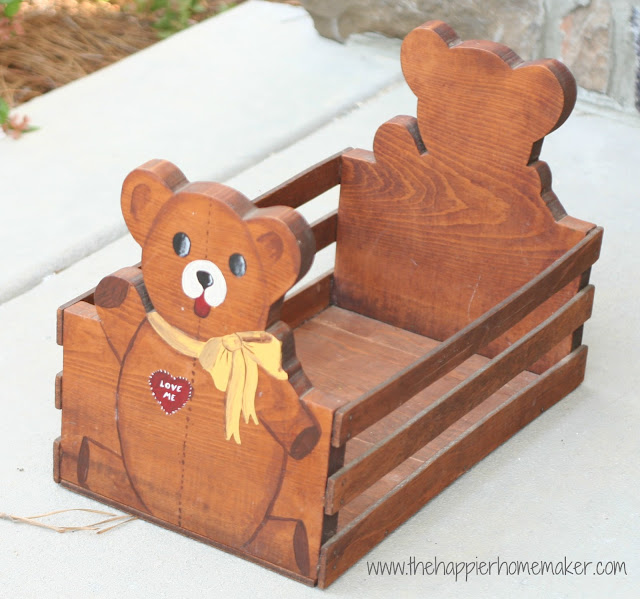 A close up of a brown teddy bear wood basket