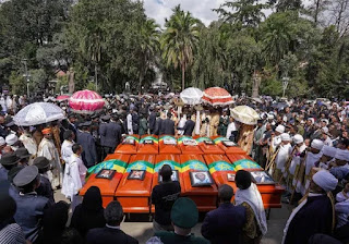 Mass funeral service held for Ethiopian crash victims.