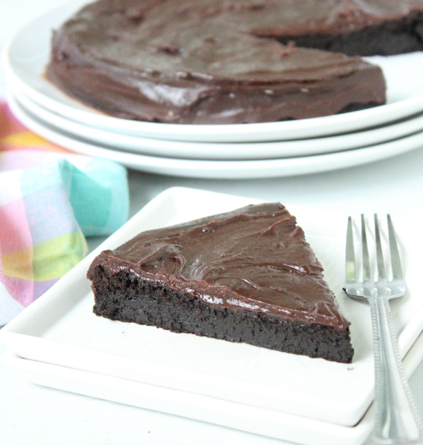 Dive into this incredibly fudgy chocolate cake..it's just a few simply ingredient and no flour needed! From Table for Seven