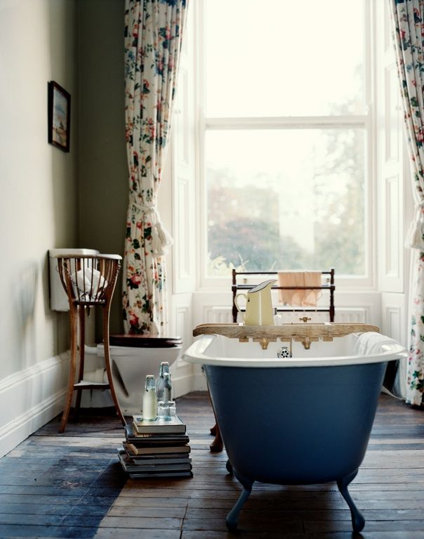 Colorful Claw foot tub and books in bathroom- time to relax - via design addict mom