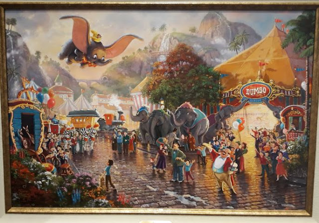 Dumbo Flying over city village circus