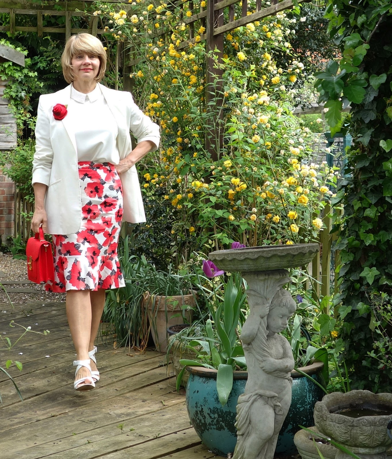 Red and white poppy skirt, white top with Peter Pan collar and ivory jacket