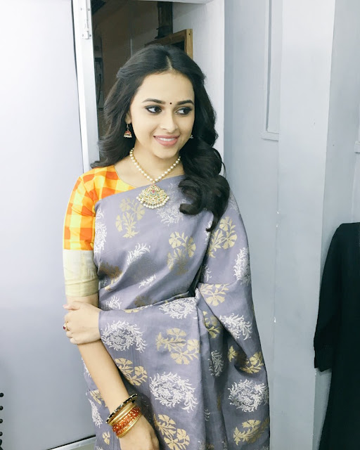 Actress Sri Divya Latest Stills in Saree