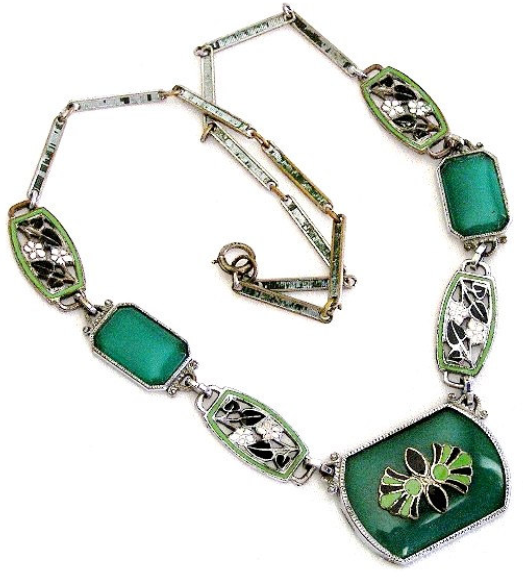 Art Deco necklace with green chyrsoprase and black and green enamel designs, set in sterling silver. Via Diamonds in the Library.