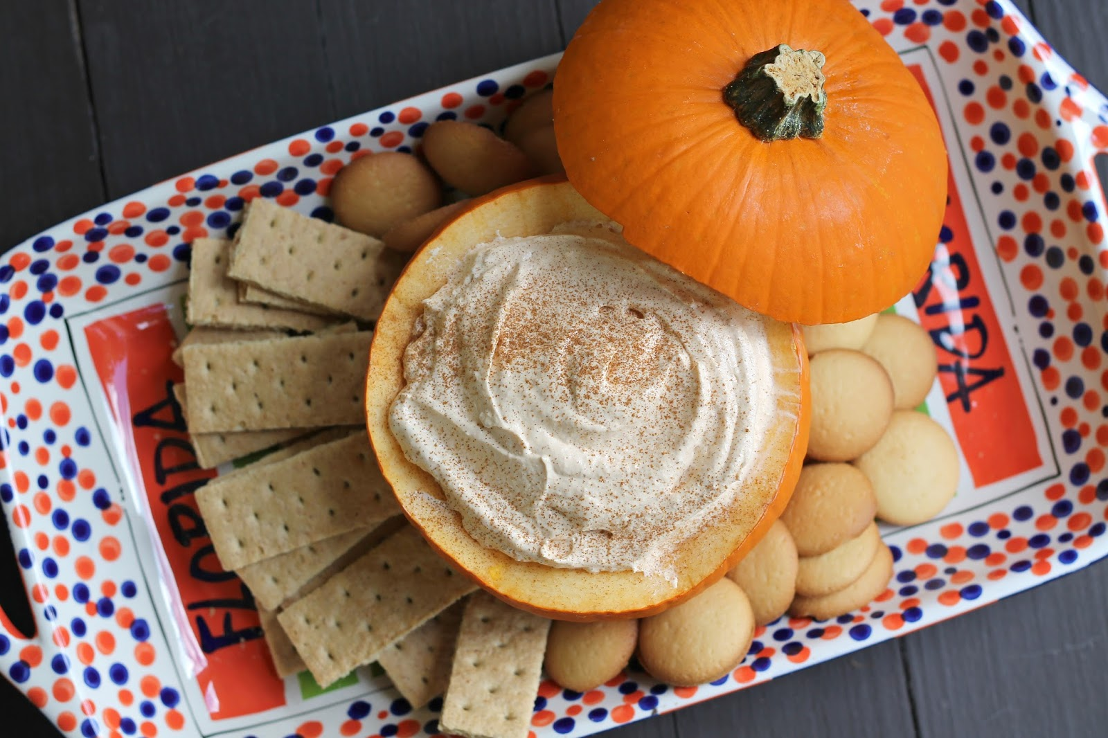 North Carolina lifestyle blogger, Christina shares an easy pumpkin dip recipe! Plate this recipe inside of a pumpkin to add to the table decor!
