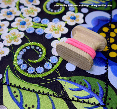 Unwrapped beading koma and bead thread ready to plunge. (Wild Child Japanese Bead Embroidery by Mary Alice Sinton)