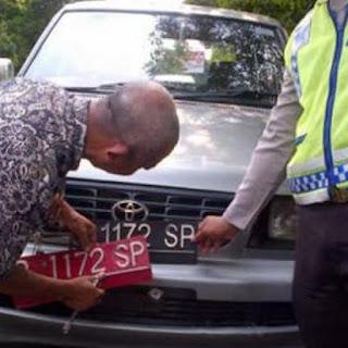 Ini Hukuman Jika Mengganti Plat Merah Kendaraan Dinas