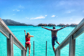 Jumping off Overwater Bungalow in Bora Bora