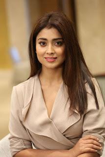 Shriya Saran looks stunning sexy with her huge boobs in formals at Gautamiputra Satakarni Team Meet