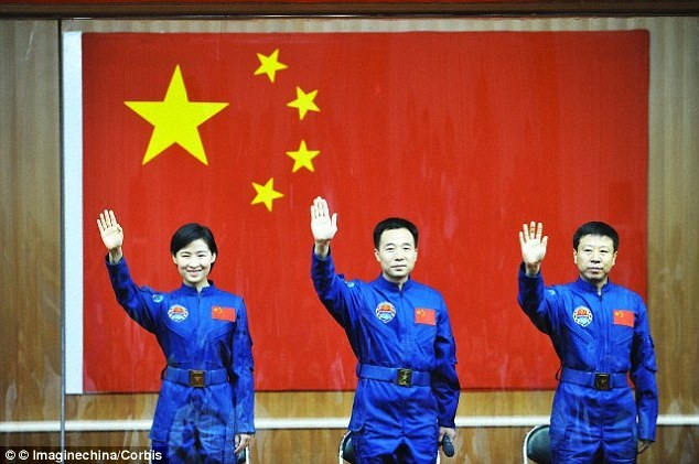 Chinese National Space Administration and astronauts using the Chinese flag as a backdrop.