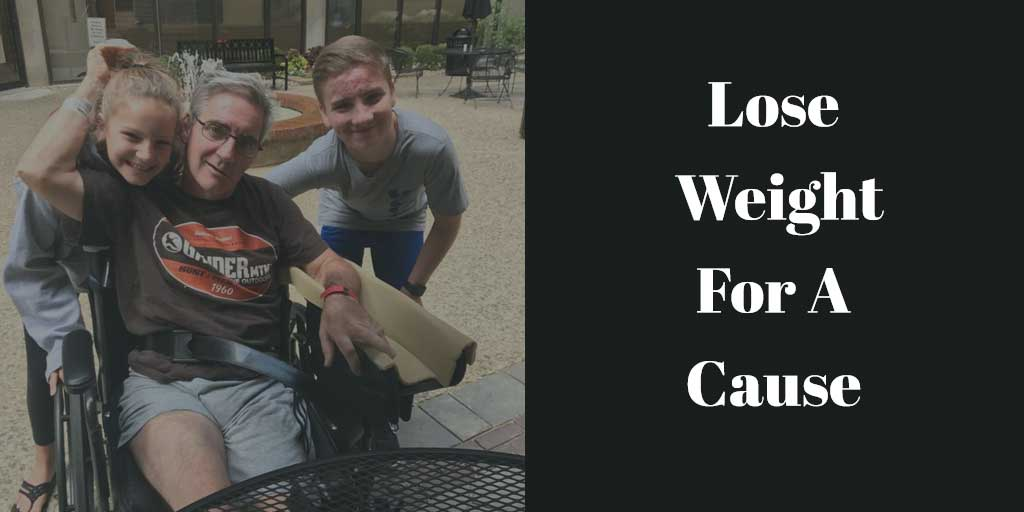 Rick in a wheelchair with two of his children after his stroke. Lose weight and help out!