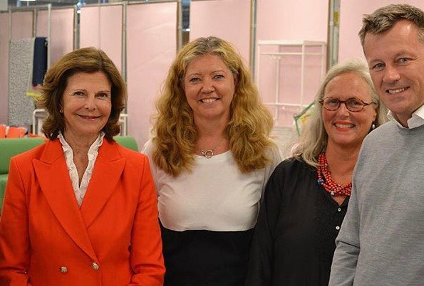 Queen Silvia wore a red long blazer for SilviaBo project at Ikea in Älmhult and visit the Themed Gardens exhibition at Solliden
