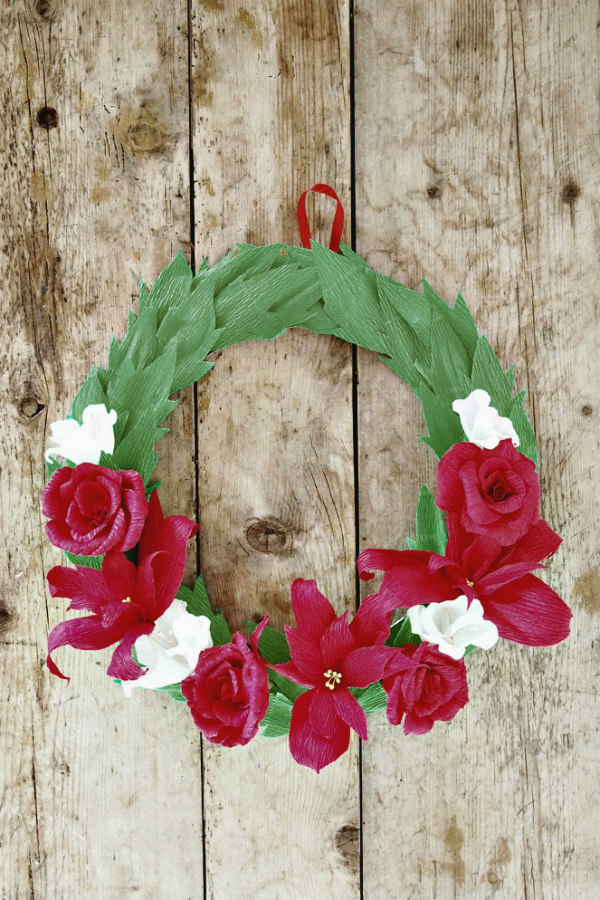red white, and green crepe paper flowers Christmas wreath