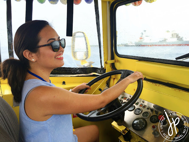 woman with sunglasses driving amphibious vehicle