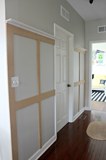 This could be the answer to an organized entryway or drop zone! How to Build a Board and Batten Coat Rack Wall