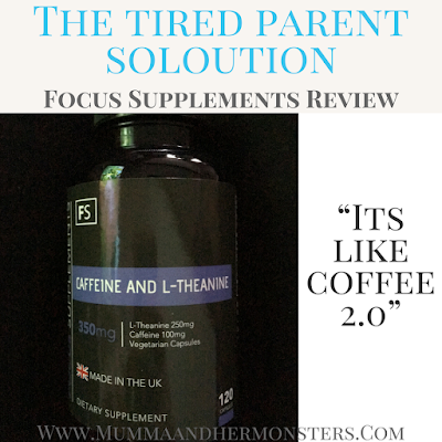 focus supplements caffiene and L-Theanine tablets in a black bottle with a blue band around the top