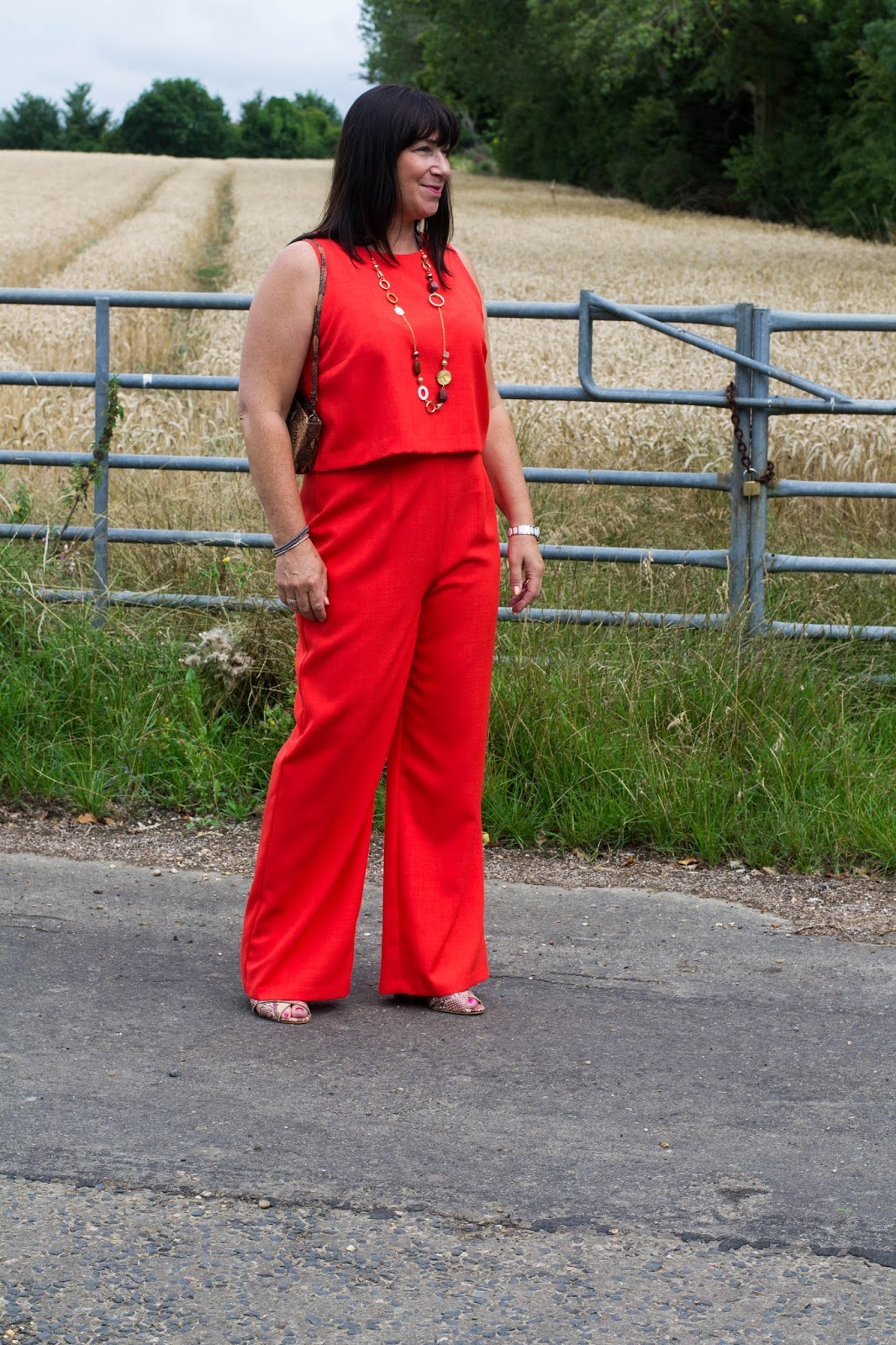 Jacqui Berry from Mummabstylish in orange flared trousers and cropped top