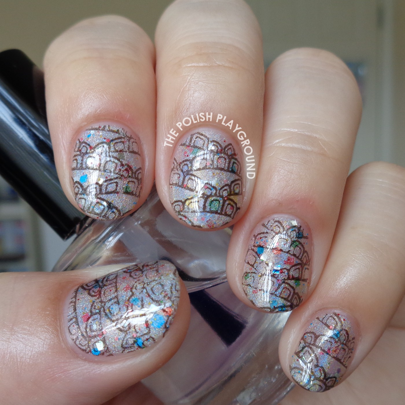Holographic and Glittery Base with Black Pattern Stamping Nai Art