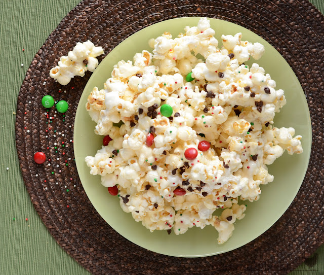 Marshmallow popcorn with chocolate, homemade sticky popcorn, popcorn with marshmallows and M&Ms