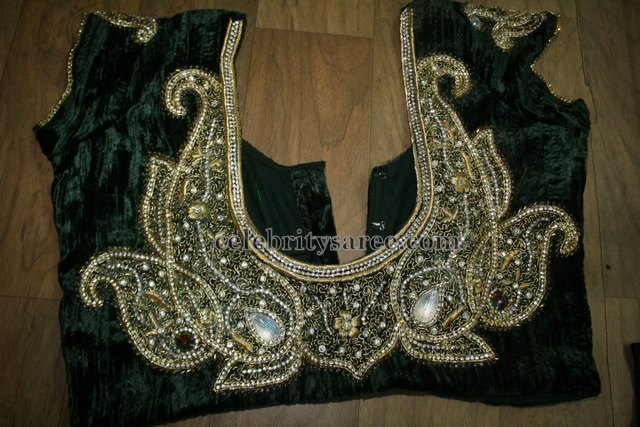 c5e3811dd361e1 Dark green velvet cap sleeves blouse with nice spring and stone work  designer applique at the back neck and round deep neck pattern with kundan  and sequins ...