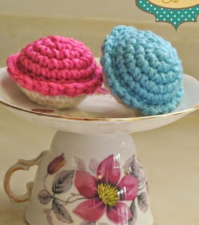 http://www.craftsy.com/pattern/crocheting/toy/tea-party-cupcakes/88457