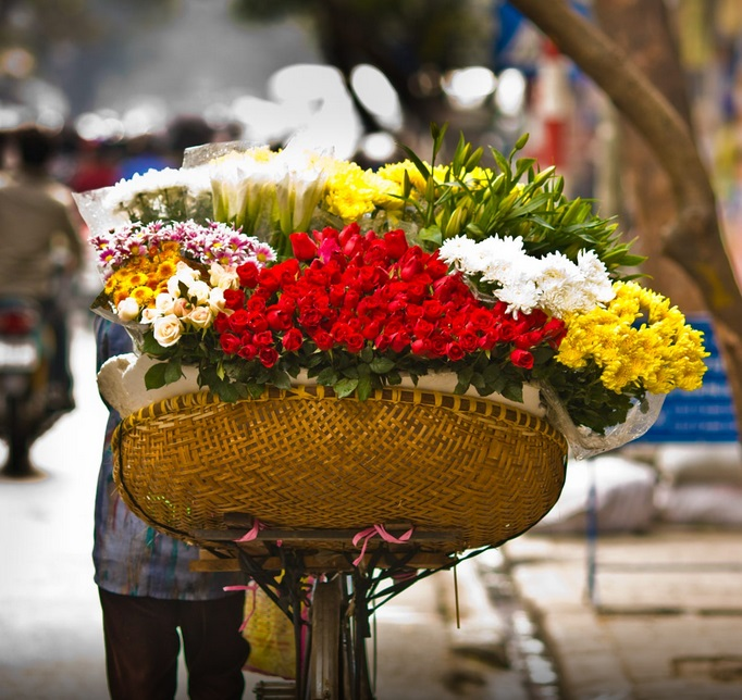 flower vendor in streets of Hanoi's old quarter