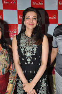 Kajal Aggarwal in lovely Black Sleeveless Anarlaki Dress in Hyderabad at Launch of Bahar Cafe at Madinaguda 046.JPG