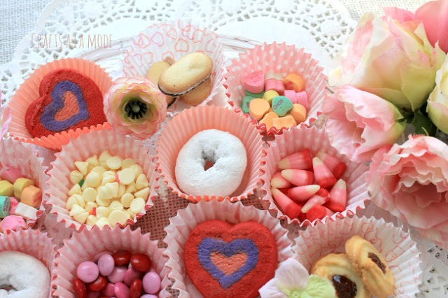 Candy and cookies in Valentine cupcake papers