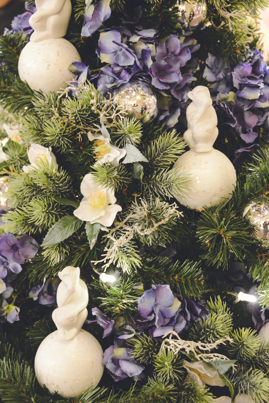 Floral white cream, purple violet faux flowers and monkeys Christmas tree decorations