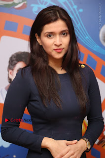 Actress Mannara Chopra Stills in Blue Short Dress at Rogue Song Launch at Radio City 91.1 FM  0013.jpg