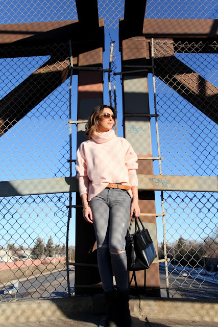 Oversized blush sweater and distressed denim