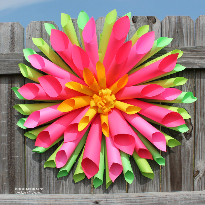Make a vivid paper craft using Astrobrights paper and hot glue.