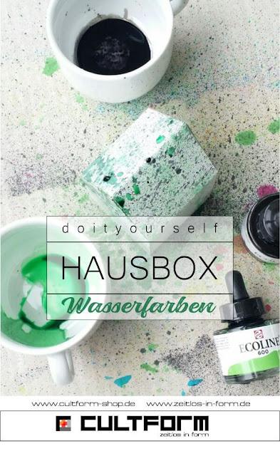Die Hausbox von Cultform. Ein eindrucksvolles und doch einfaches DIY: kleine Geschenke individuell modern verpacken im aktuellen Watercolor-Trend. Pingrafik mit Text, Hausbox mit grünen und schwarzen Sprenkeln