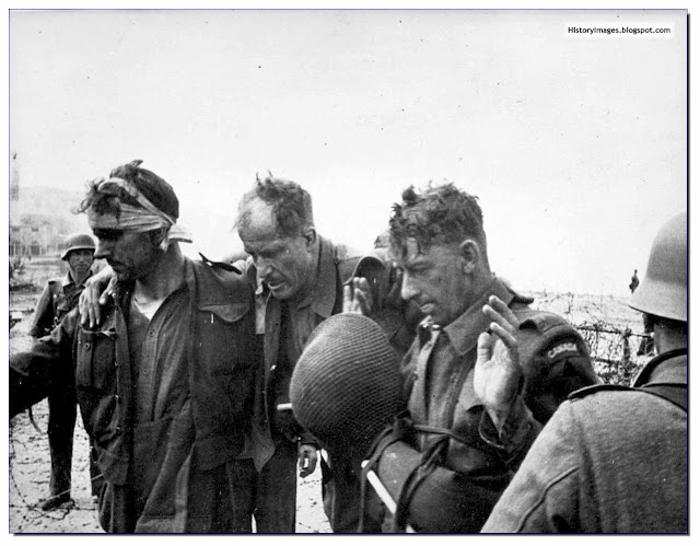 Three Canadian soldiers captured  by the Germans during the Dieppe Raid