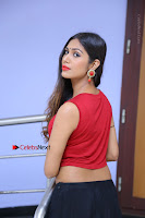 Telugu Actress Nishi Ganda Stills in Red Blouse and Black Skirt at Tik Tak Telugu Movie Audio Launch .COM 0260.JPG