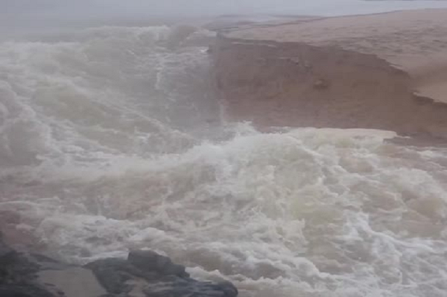 A man captures the moment when a river cuts a new channel to the ocean
