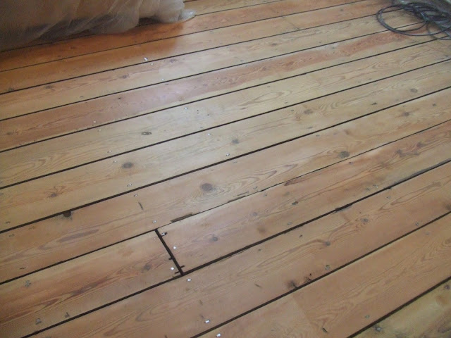 floorboards sanded with a professional floor sander