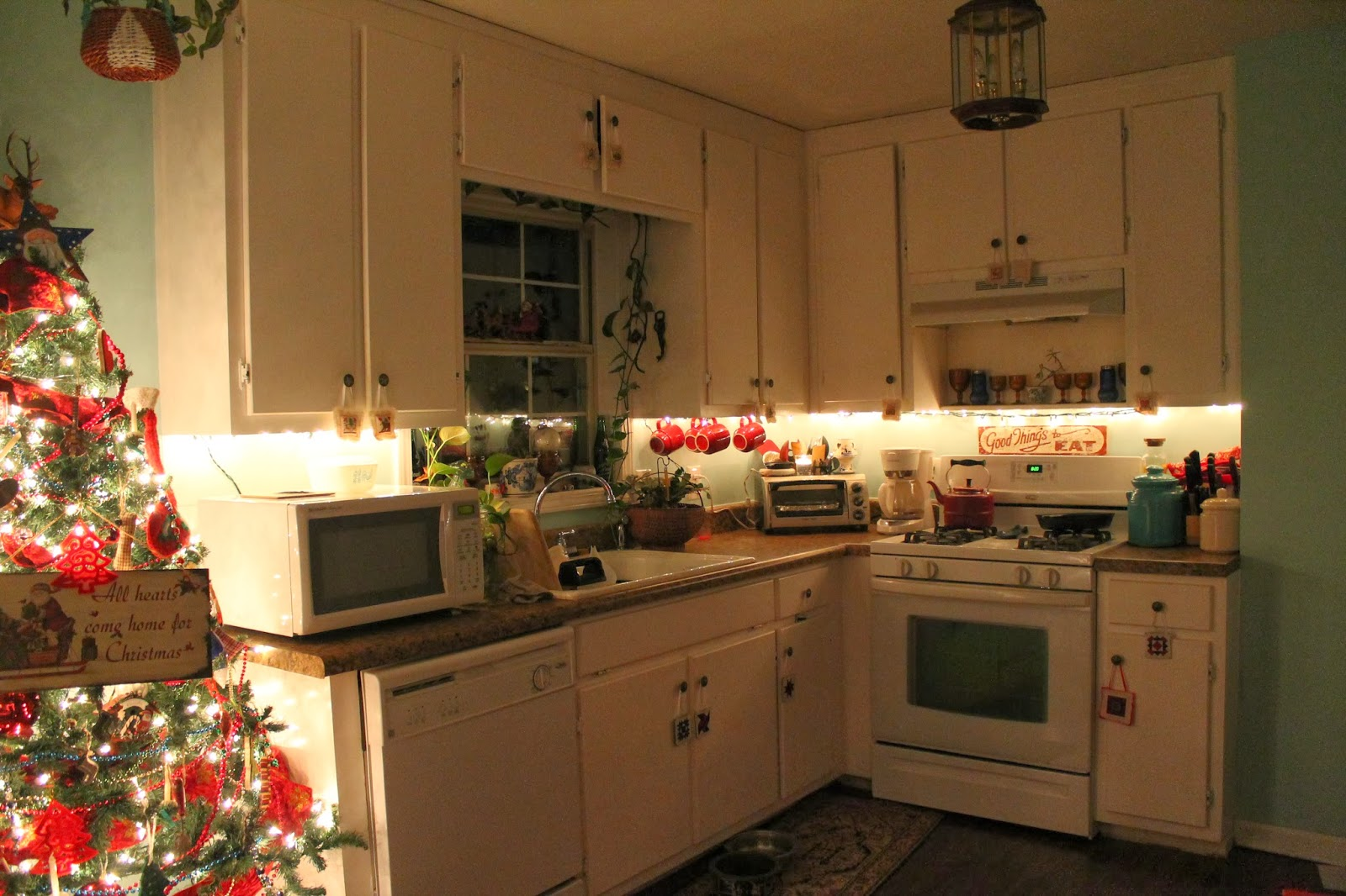 diy under cabinet lighting with white kitchen cabinet lighting Christmas decorating is in full swing over here Today marked my third and final day of decorating While I was working in the kitchen last night